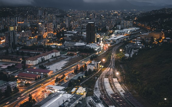 Fondos de pantalla Ciudad de noche, edificios, carretera, ferrocarril.