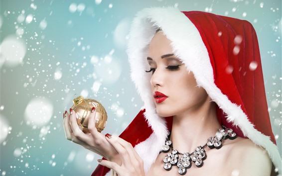 Wallpaper Beautiful Christmas girl, look at Christmas ball, snow
