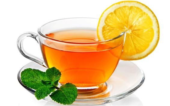 Wallpaper One glass cup of tea, lemon slice, green mint