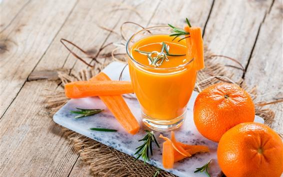 Fond d'écran Une tasse de jus d'orange, des oranges