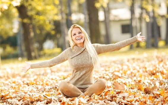 Wallpaper Happy blonde girl, hands, leaves, autumn