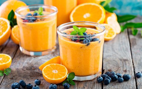 Fond d'écran Deux tasses de jus d'orange, oranges