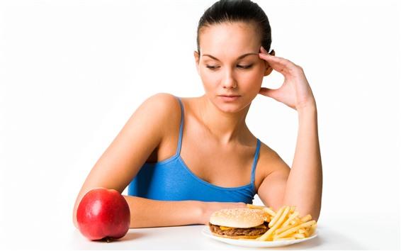 Wallpaper Girl look at apple, hamburger, white background