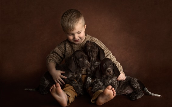 Wallpaper Little boy and three puppies