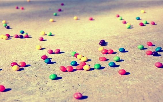 Fond d'écran Pilules de bonbons colorés, sol