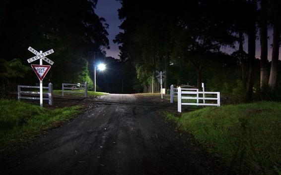 Обои Ночь, дорога, перекресток, железная дорога, огни, деревья, забор