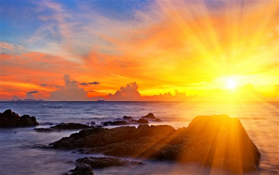 Wallpaper Sun rays, sunset, sea, glare, rocks, clouds