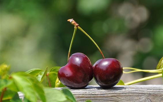 Обои Две красные вишни, зеленые листья