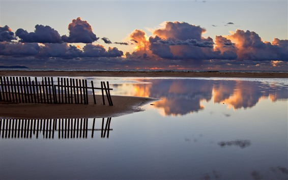 Wallpaper Fence, coast, sea, thick clouds, sunset