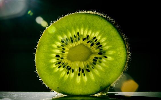 Fond d'écran Une tranche de kiwi vert, texture