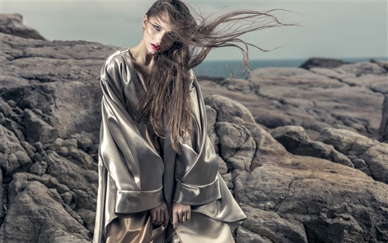 Wallpaper Young girl, style, long hair, wind, stones, sea