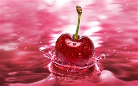 Preview wallpaper Red cherry falling into the water the moment