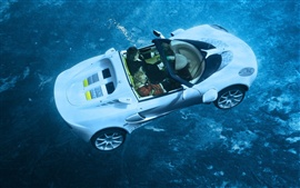 White sports car sink into the sea