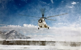 Mi-8 Helicopter over the snow