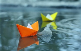 Preview wallpaper Small paper boats in water
