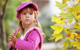 Preview wallpaper Cute little girl holding a maple leaf