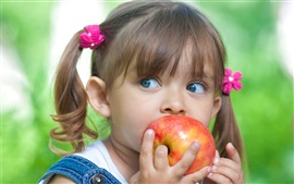 Preview wallpaper Cute little girl eating apple