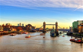 England London bridge river ships at sunset