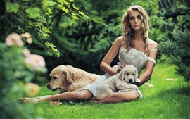 Preview wallpaper Beautiful girl with a dog in the grass
