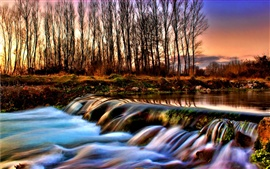 River and the forest of autumn dusk