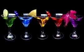 A few cups of different colors cocktail