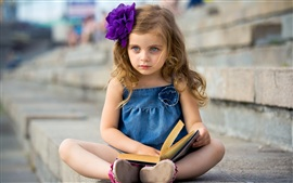 Preview wallpaper Cute little girl reading a book