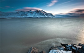 Iceland charming scenery, sea, snow-capped mountains sunset