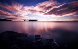 Preview wallpaper Purple sunset, white clouds in the sky, lake water