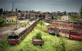 Preview wallpaper Abandoned subway cars and trains, overgrown with weeds