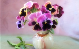 Home decorated with flowers, the circular vase of violets