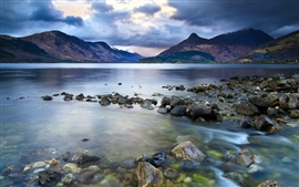 Lake, mountains, stones, dark clouds sky, nature landscape