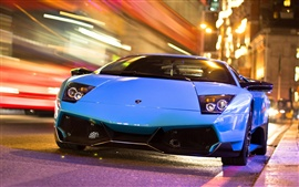 Preview wallpaper Lamborghini blue car in the city night road