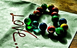 Love heart-shaped, colored glass beads