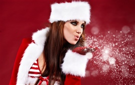 Christmas girl blowing snowflakes