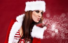 Chica soplando copos de nieve de Navidad