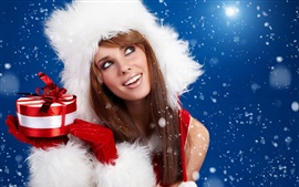 Preview wallpaper Christmas girl holding a Christmas gift