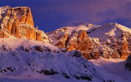 Italy's red rocks snow-capped mountains scenery close-up