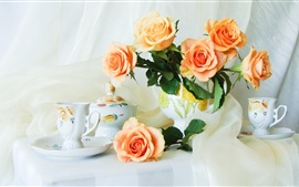 Still Life on the desktop, orange roses, cups, vase