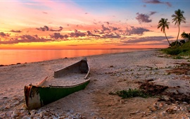Preview wallpaper The sunset beach scenery, the sea, the broken boat, the red clouds