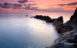 Preview wallpaper Coast rocks, sky, water, sunset landscape