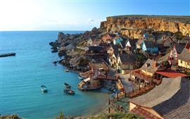 Sea, villages, houses, cliffs, boats, blue sky
