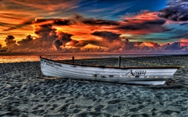 Sunset sea beach landscape, cloudy sky, boat
