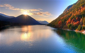 The beauty of autumn, the mountains, the sun, lake, trees
