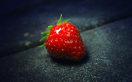A fresh red strawberry macro close-up