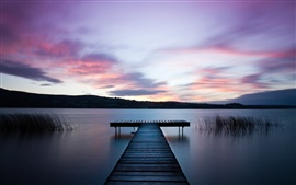 Ireland landscape, river, water surface, wooden bridge, dawn, purple sky