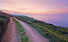 Preview wallpaper Spain scenery, road, footpath, grass, coast, sea, evening sunset