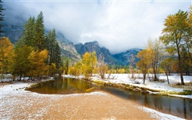 Early winter nature landscape, trees, snow, river, mountains