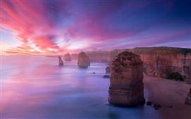 Preview wallpaper Coast landscape, mountains, rocks, reefs, sunset, purple sky