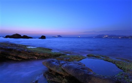 Preview wallpaper Coast, sea, rocks, dusk, blue color, moss, city lights