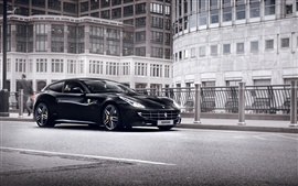 Preview wallpaper Ferrari FF black supercar at city street